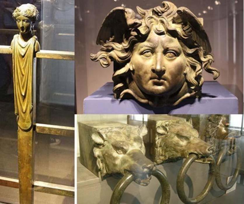 Algunas de las decoraciones de las barcos de Calígula halladas en el lago de Nemi: barandilla de bronce (CC BY SA 2.0), escultura de un rostro (Miguel Hermoso Cuesta / CC BY SA 3.0), y aros de latón recuperados en 1895. Éstos últimos servían para fijar los extremos de las vigas en voladizo que soportaban cada una de las posiciones de los remeros en la ' seconda nave'. (CC BY SA 3.0)