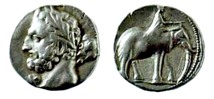Dishekel cartaginés de plata con la efigie de Amílcar Barca, célebre general cartaginés a quien la leyenda vincula con Barcelona.(Public Domain)