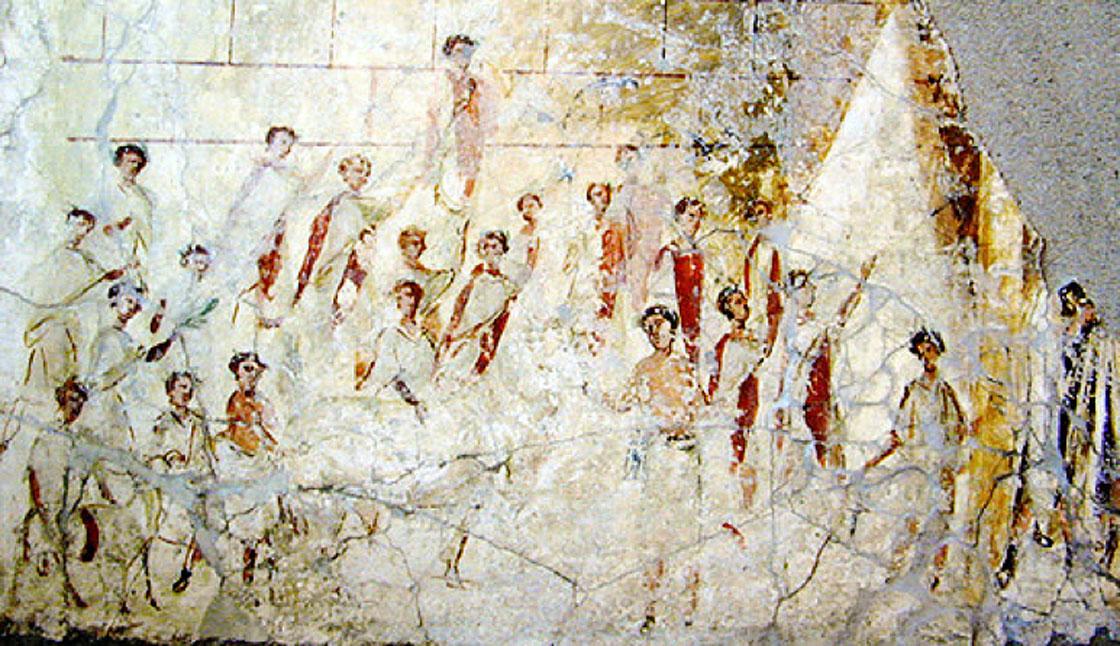 Fresco de un edificio cercano a Pompeya con una rara representación de hombres romanos vistiendo 'togae praetextae' con bordes de color rojo oscuro. Data de principios de la época imperial y probablemente muestre un evento de las Compitalia, popular festividad callejera de la antigua Roma. Fuente: Brian0918/Dominio público.