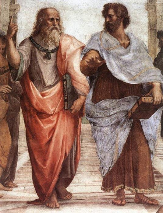 Platón (izquierda) y Aristóteles (derecha), detalle del fresco La Escuela de Atenas, obra de Rafael. El gesto de Aristóteles apunta a la tierra, simbolizando su creencia en el conocimiento alcanzado a través de la observación empírica y la experiencia, mientras se observa en su mano izquierda un ejemplar de la Ética nicomáquea. Por su parte, Platón señala al cielo con su dedo índice, lo que revela su fe en las Ideas. El libro que lleva Platón en su mano izquierda es una de sus obras, el Timeo (Public Domain)
