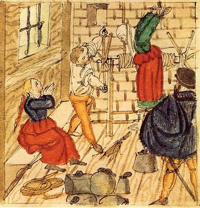 Ilustración de 1577 en la que una acusada de brujería es torturada. (Public Domain)