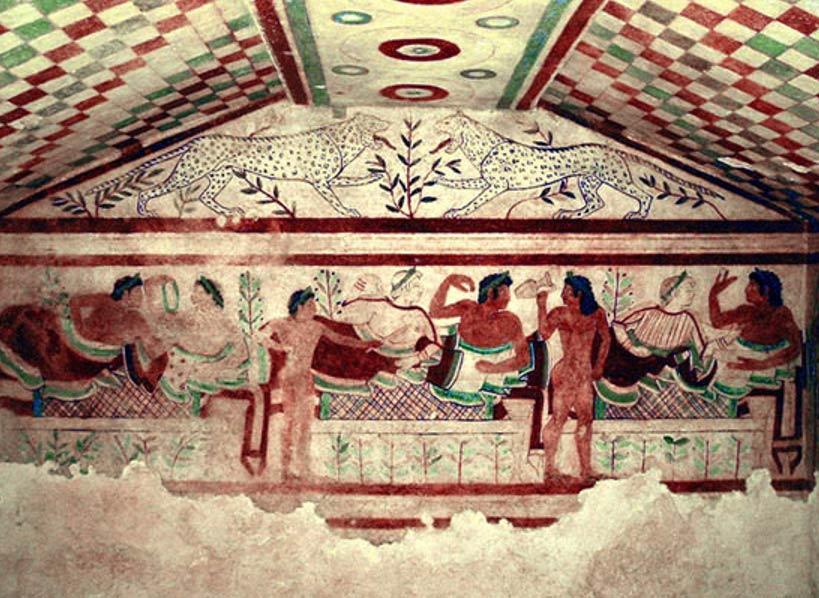 Ejemplo de una elaborada tumba etrusca: pinturas murales en la cámara funeraria de la llamada Tumba de los Leopardos, situada en la necrópolis etrusca de Tarquinia, ubicada en la región italiana del Lazio. Imagen: Wikipedia
