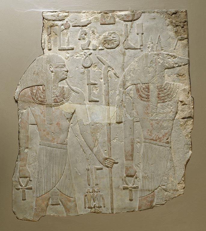 Gebelein es un complejo de yacimientos arqueológicos del antiguo Egipto conocido desde hace muchos años. Este relieve hallado en Gebelein, que muestra al dios con cabeza de chacal Wepwawet y al dios de la Tierra Geb, fue adquirido por Henry Walters en 1925. (Wikimedia Commons)