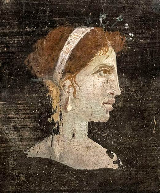 Un retrato pintado póstumo de Cleopatra VII del Egipto ptolemaico del Herculano romano, realizado durante el siglo I d.C., es decir, antes de la destrucción de Herculano por la erupción volcánica del Vesubio. (Ángel M. Felicísimo / CC BY 2.0)