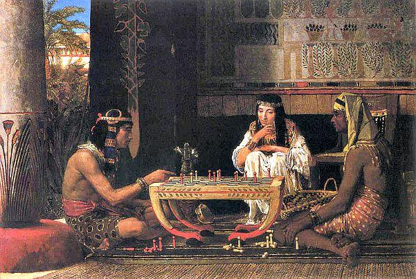 """Una de las hipótesis sobre los orígenes del ajedrez apunta hacia el Antiguo Egipto. """"Egipcios jugando al ajedrez"""", obra de Sir Lawrence Alma-Tadema (1879). (Wikimedia Commons)"""