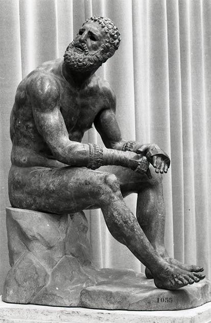 La lucha libre y el boxeo fueron deportes valorados durante los antiguos juegos olímpicos. El boxeador de bronce en reposo o el boxeador del Quirinal es una escultura griega helenística de un boxeador desnudo excavado en Roma. (Paolo Monti / CC BY-SA 4.0)