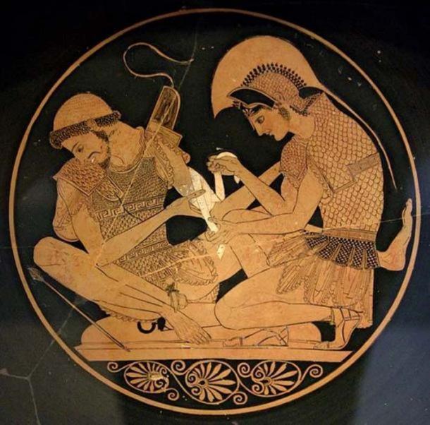 Aquiles atiende a Patroclus herido por una flecha, identificado por inscripciones en la parte superior del jarrón. Tondo de un ático de figura roja kylix, alrededor del año 500 a.C. De Vulci. ( Dominio público )