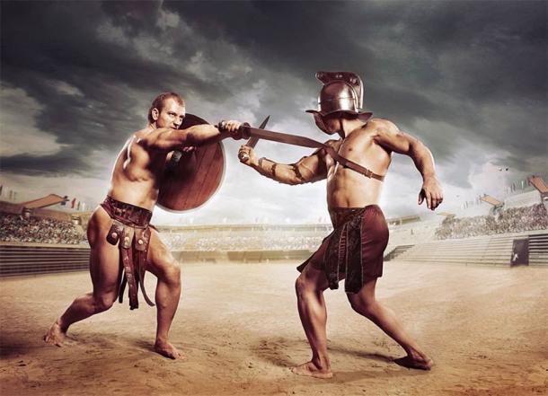 Gladiadores luchando en la arena del Coliseo (Fotokvadrat / Adobe Stock)
