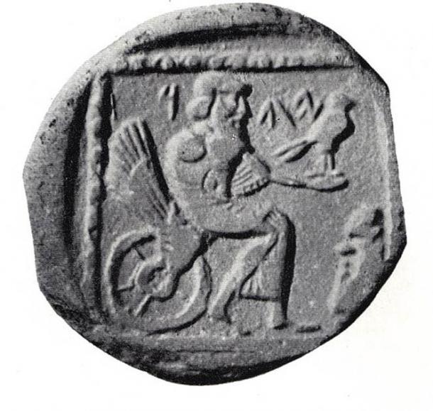 """Dracma fenicia, siglo IV a.C., expuesto en el Museo Británico. La moneda muestra una deidad sentada, etiquetada como """"YHW"""" (Yahu) o """"YHD"""" (Judea). (Dominio público)"""