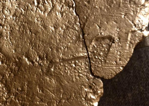 Imagen del cordón en forma de z y la impresión textil en la vasija de barro. (Instituto de Arqueología de UHI)