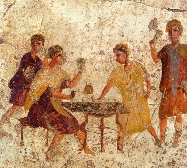 Jugadores de dados en una pintura mural de Pompeya (Dominio Publico)