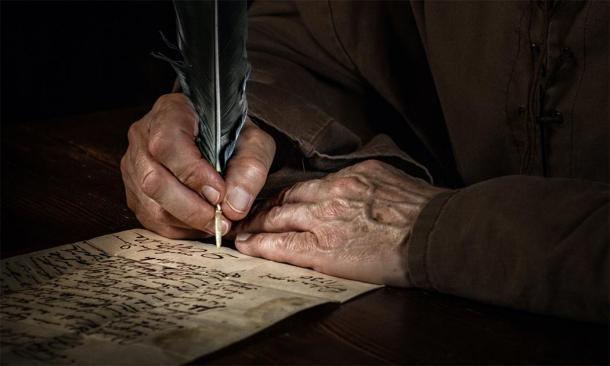 Un monje escribiendo una lengua antigua. (Thomas Mucha/ Adobe Stock)