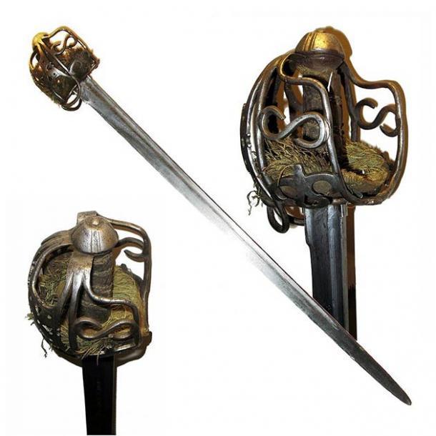 """Un ejemplo de una espada ancha con empuñadura de cesta """"perfecta"""" que es similar a la que Fionntan Hughes encontró con su nuevo detector de metales en Irlanda del Norte. (Rama / CC SA-BY 2.0)"""