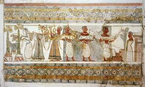 Portada - Lateral pintado de un sarcófago hallado en Agia Triada, Creta, datado en torno al 1400 a. C. (yeso pintado sobre piedra caliza). La pintura pone de manifiesto las relaciones que existían antiguamente entre minoicos y egipcios. (Dominio público)