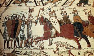 Portada - Ataque de la caballería en el tapiz de Bayeux. Este tapiz narra con imágenes la invasión y conquista normanda de Inglaterra. Fuente: Steven Zucker/CC BY NC SA 2.0