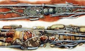 Portada - Esqueletos y representación del posible aspecto original de la tumba prehistórica de los niños en el momento del entierro. (Libor Balák)