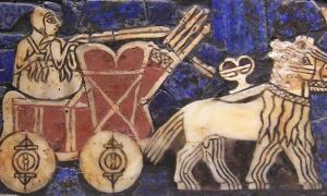 """Una representación de un carro tirado por onager en el """"estándar de batalla sumerio de Ur"""". Fuente de la foto: Wikipedia."""